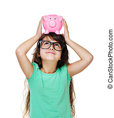 girl looking to the piggy bank on head closeup