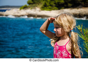 girl looking to the sea