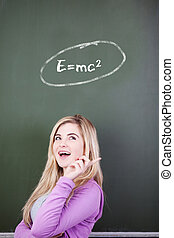 Girl Looking Up With Mathematical Formula Written On Chalkboard