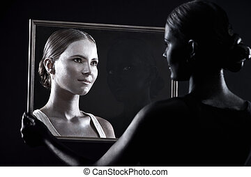 girl looks at her twin through the glass