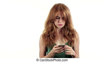 Girl looks at the photo on her phone. White background. Slow motion