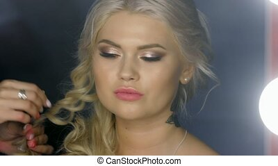 girl looks in the mirror in the Barber shop