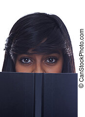 Girl looks up from book