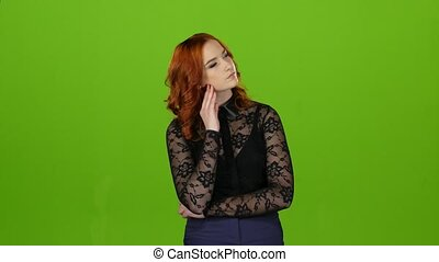 Girl looks up thoughtfully and analyzes the meaning of life. Green screen
