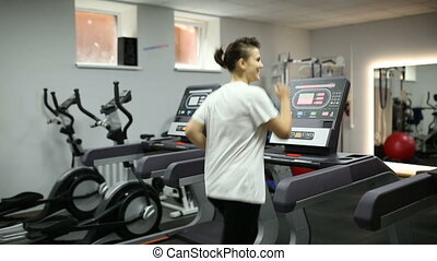 Girl loses weight on a treadmill - Fat girl exercising on...