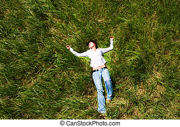 Girl lying down of grass