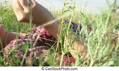 Girl lying in a field