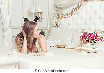 girl lying in bed with roses