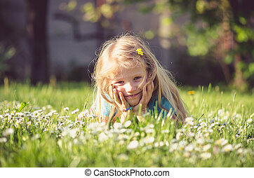 girl lying in meadow