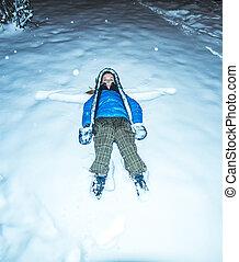 girl lying in snow night