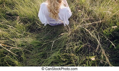 girl lying in the grass
