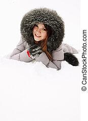 girl lying in the snow