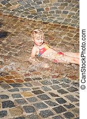 girl lying in water