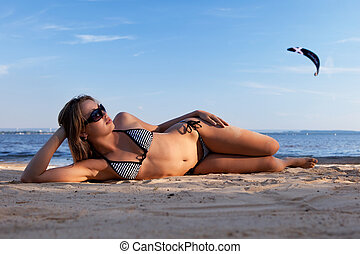 girl lying on a beach