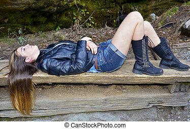 Girl Lying on a Bench