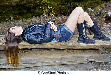 Girl Lying on a Bench