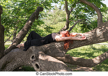 girl lying on a branch