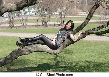 girl lying on a tree branch