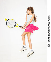girl lying on floor and pretending to play tennis