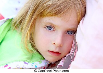 girl lying on pillow toddler looking camera