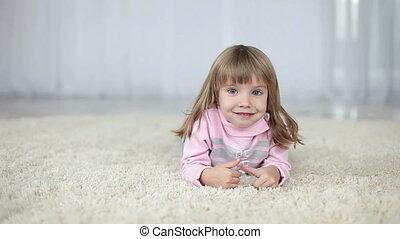 Girl lying on the carpet