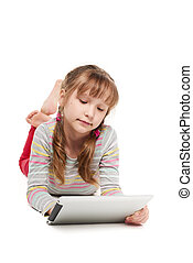 Girl lying on the floor with tablet computer