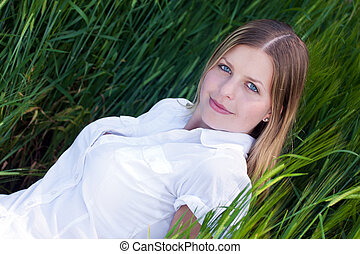 Girl lying on the green grass