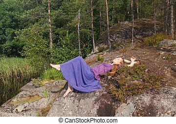 girl lying on the rocks