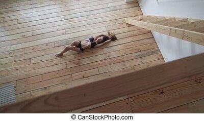 girl lying on the wooden floor