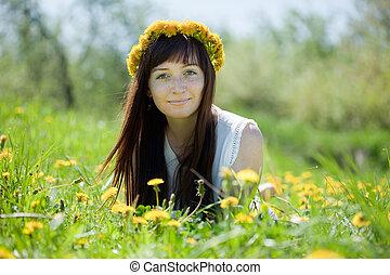 girl lying outdoor in dandelion