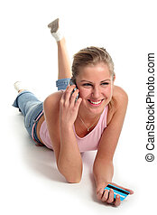Girl lying with credit card and mobile phone