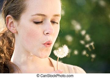 Girl make a wish - A beautiful caucasian summer teenage girl...