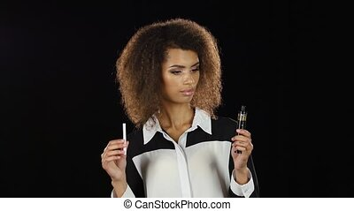 Girl makes a choice between an electronic cigarette and an...