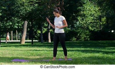 Girl makes a selfie doing yoga in park