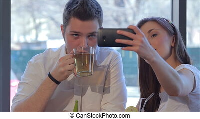 Girl makes a selfie with her boyfriend