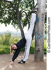 Girl makes gym split in the city park