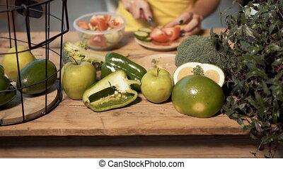 Girl Makes Nutritious Salad - Caucasian girl making a...