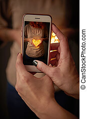 girl makes photo on mobile phone