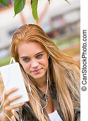 girl making a self portrait with a mobile phone