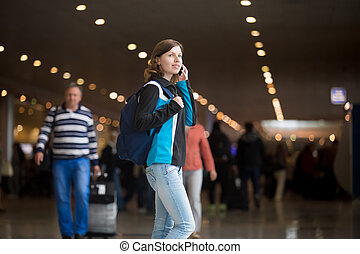 Girl making call in airport