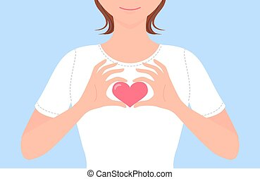 Girl making heart shape with hands