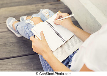 Girl making notes in the diary
