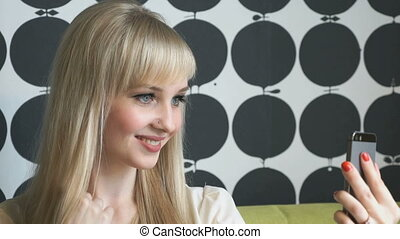 Girl making selfie photo during coffee break - Smiling young...
