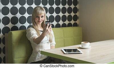 Girl making selfie photo during coffee break