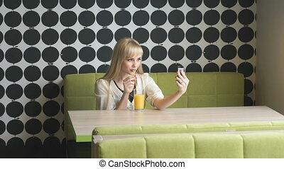 Girl making selfie photo using smartphone