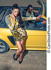 Girl man and sport yellow car