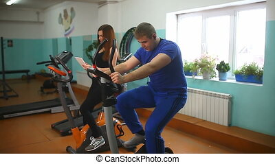 girl man gym fitness exercise bike - girl man gym fitness...