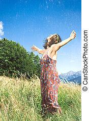 Girl meditates alone in a hillside meadow