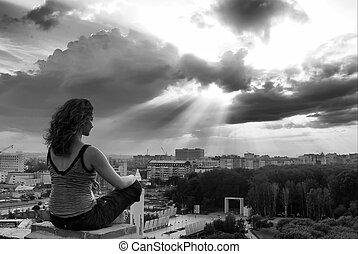 Girl meditating at sunbeam