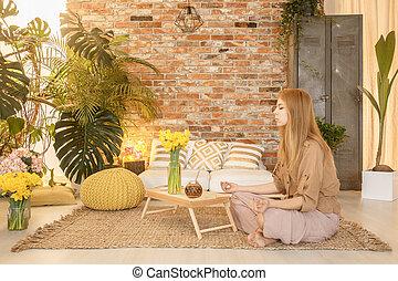 Girl meditating in room